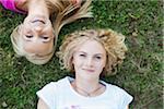 Overhead View of Teenage Girls Lying on Grass, Mannheim, Baden-Wurttemberg, Germany