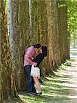 France, Paris, Young couple kissing in Versailles Park
