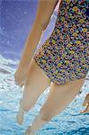 USA, Utah, Orem, Woman in floral swimwear in swimming pool