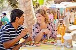 Man and woman eating at outdoor café