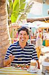 Man eating at outdoor café