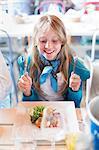 Smiling girl in restaurant