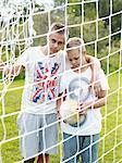 Two teenage boys playing soccer