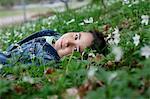 Smiling boy lying in grass