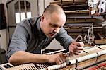 Insturment maker adjusting a piano, Regensburg, Bavaria, Germany