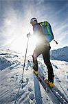 Backcountry skier on the move, with back light, Alpbachtal, Tyrol, Austria, Europe