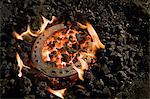 Horseshoe lying on burning coal, Landshut, Bavaria, Germany