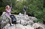 Girl hikers taking a break on rocks