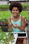 Girl holding lettuce in nursery