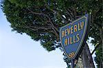 Beverly Hills sign under tree