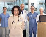 Medical professionals, portrait (focus on female nurse in foreground)