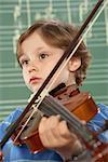 Schoolboy (5-10) playing violin, close-up