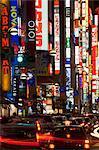 Japan, Tokyo, Shinjuku, neon signs and traffic, blurred motion