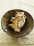 Oyster mushrooms (Pleurotus ostreatus) in bowl, elevated view
