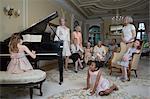 Girl (6-8) playing piano at party