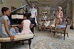 Girl (5-7) playing piano at party