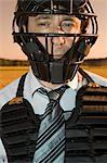 Businessman in protective sportswear, outdoors, portrait