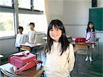 Children (5-9) standing in classroom, portrait