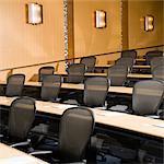 Rows of desk seats in empty auditorium