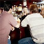 Men Sitting At Bar