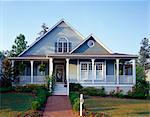 Gray house with wraparound porch, exterior