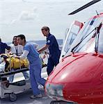 Paramedics removing patient from medevac
