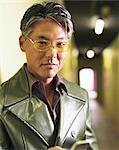 Man standing in hotel hallway, portrait