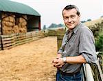 Farmer Leaning on a Gate in a Paddock on a Farm