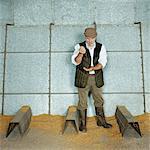 Farmer in a Barn Pouring Grain Through his Hands