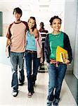 Portrait of Four School Students Walking Down a Corridor