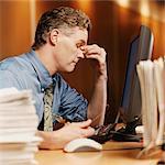 Stressed Businessman Sitting at His Desk