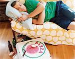 Thirty something Man Lying Asleep on a Sofa in an Apartment