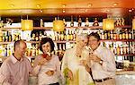 Four Friends Leaning Against a Bar