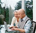 Senior Couple Using a Laptop Computer