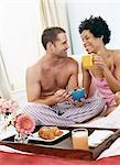 Couple Enjoying Breakfast in Bed