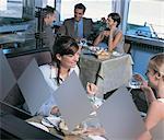 Businessmen and Businesswomen Enjoying a Meal in a Restaurant