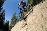 Downhill mountain biker on rock