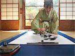 Japan, Tokyo, woman writing calligraphy