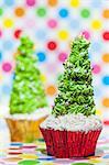 Two Christmas tree cupcakes