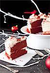 A Slice of Red Velvet Cake on a Napkin; Remainder of the Cake on a Pedestal Dish