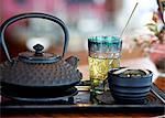 A tea-themed still life featuring a black teapot