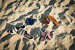 Sandals on sandy beach