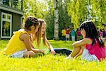 Girls sitting on grass talking