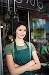 Portrait of teenage girl through cafe window