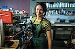 Portrait of teenage waitress in coffee house