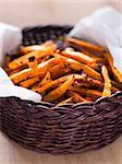 close up of a basket of sweet potato fries