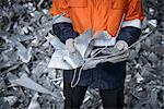 Close up of worker holding scrap aluminum