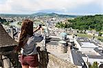 Female tourist photographing view of the city, Salzburg, Austria