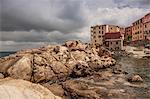Rocks and houses Marciana town, Elba Island, Italy