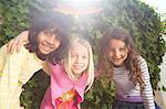 Portrait of three girls in garden